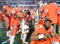 Dec 31, 2016; Glendale, AZ, USA; The Clemson Tigers celebrate after the game against the Ohio State Buckeyes during the 2016 CFP semifinal at University of Phoenix Stadium. The Clemson Tigers won 31-0. Mandatory Credit: Joe Camporeale-USA TODAY Sports