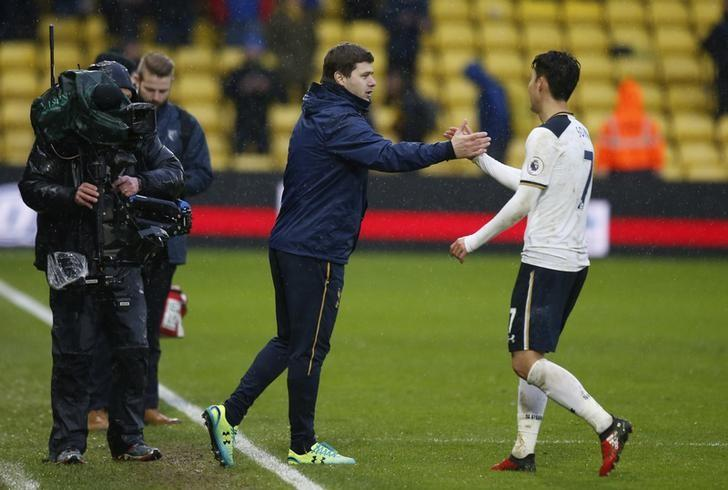 Britain Football Soccer - Watford v Tottenham Hotspur - Premier League - Vicarage Road - 1/1/17 Tottenham manager Mauricio Pochettino with Son Heung-min after the match  Action Images via Reuters / Paul Childs Livepic