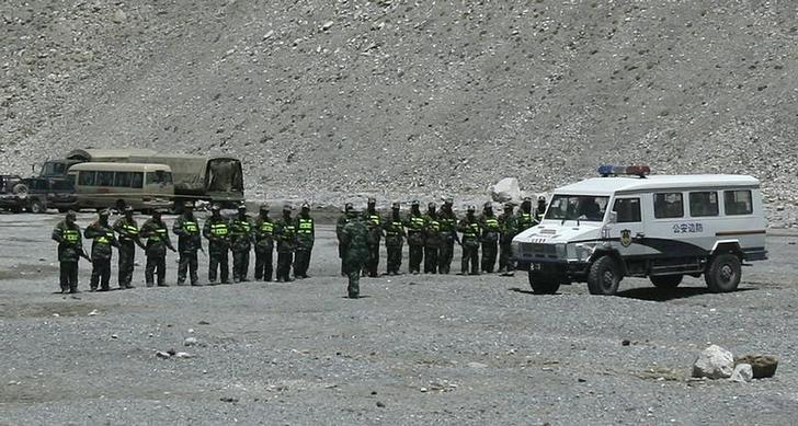 Armed Chinese border police stand in formation at a camp near the base camp of Mount Everest, also known as Qomolangma, in the Tibet Autonomous Region April 30, 2008. REUTERS/David Gray/Files