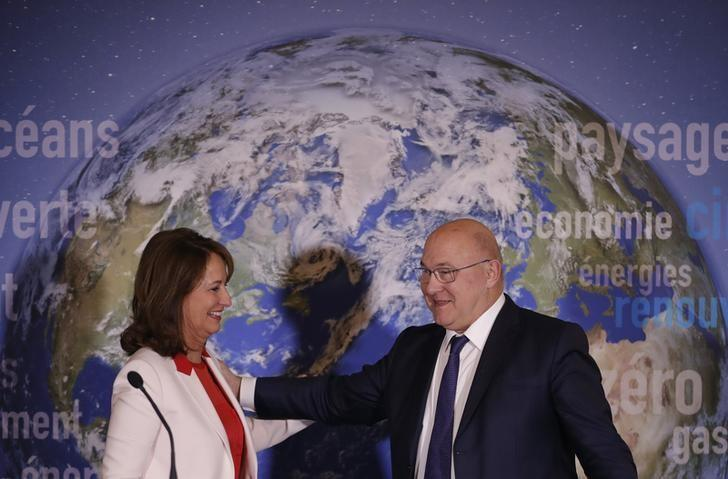 French Minister for Ecology, Sustainable Development and Energy Segolene Royal (L) and Finance Minister Michel Sapin attend a news conference to introduce France's first state green bond in Paris, France, January 3, 2017. REUTERS/Christian Hartmann