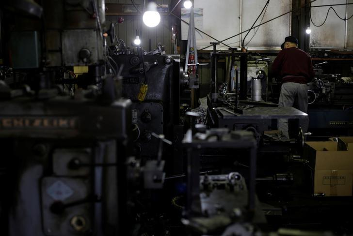 A man works at a factory that manufactures iron pipe fittings in the Keihin industrial zone in Kawasaki, south of Tokyo, Japan, April 16, 2013. REUTERS/Toru Hanai/File Photo