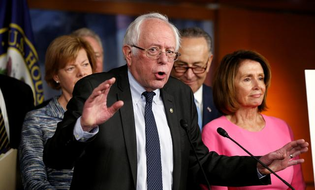 Former Democratic presidential candidate Bernie Sanders speaks to reporters as Senate Democratic Leader Chuck Schumer (2nd R) and House Democratic Leader Nancy Pelosi (R) stand with him following their meeting with U.S. President Barack Obama on congressional Republicans' effort to repeal the Affordable Care Act on Capitol Hill in Washington, U.S., January 4, 2017. REUTERS/Kevin Lamarque