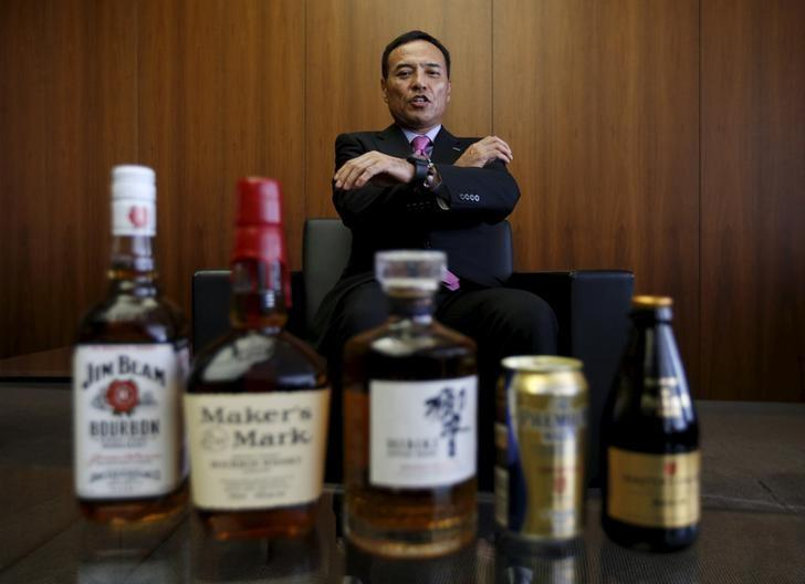 Suntory Holdings Ltd's President and CEO Takeshi Niinami speaks behind the company's alcoholic beverages during an interview with Reuters at the company headquarters in Tokyo, Japan, October 26, 2015.  REUTERS/Toru Hanai
