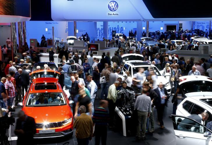 Visitors inspect exhibited Volkswagen cars at the Volkswagen booth during the Frankfurt Motor Show (IAA) in Frankfurt, September 21, Germany. REUTERS/Ralph Orlowski/File Photo