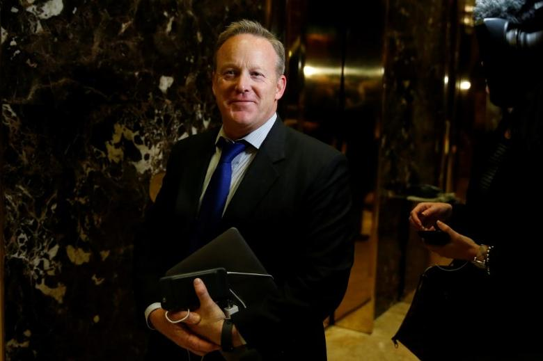Chief Strategist & Communications Director for the Republican National Committee Sean Spicer arrives in the lobby of Republican president-elect Donald Trump's Trump Tower in New York, New York, U.S. November 14, 2016.  REUTERS/Carlo Allegri/File Photo