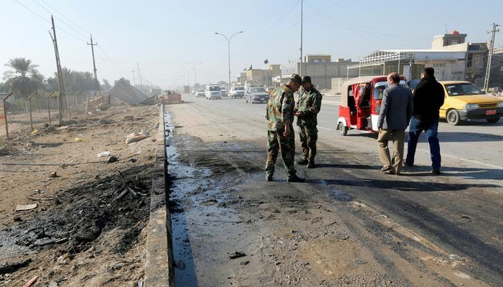 Iraqi security forces stand at the site of car bomb attack in the predominately Shi'ite Muslim neighbourhood of al-Obaidi, Iraq, January 5, 2017. REUTERS/Wissm al-Okili