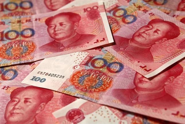 1月6日、トランプ相場の裏側で、中国人民元が神経質な動きをみせている。中国の短期金利が100%を超える水準まで上がり、人民元が上昇。中国当局の対応に関し、さまざまな思惑が浮上している。写真は北京で2010年11月撮影(2017年 ロイター/Petar Kujundzic)