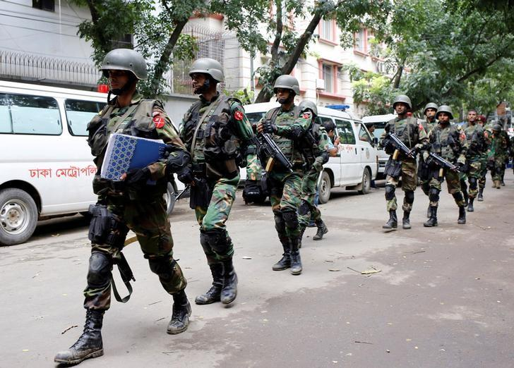 Army soldiers patrol near the Holey Artisan restaurant after gunmen attacked the upscale cafe, in Dhaka, Bangladesh, July 2, 2016. REUTERS/Mohammd Ponir Hossain/Files
