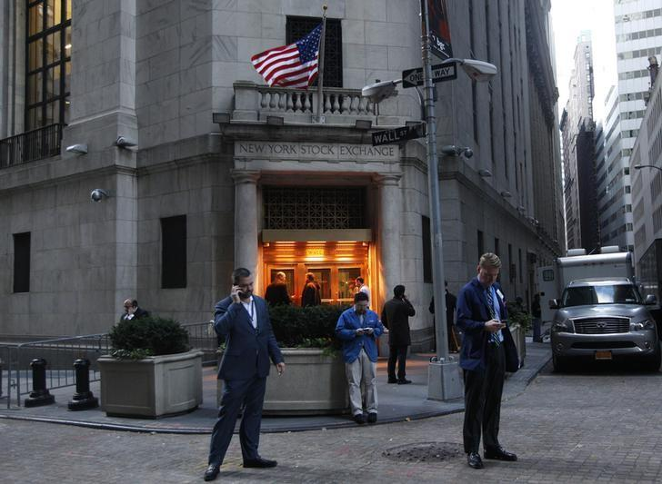 Traders stand outside the New York Stock Exchange prior to the opening bell October 31, 2012.  REUTERS/Brendan McDermid/Files
