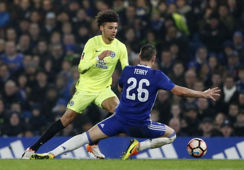 Britain Football Soccer - Chelsea v Peterborough United - FA Cup Third Round - Stamford Bridge - 8/1/17 Chelsea's John Terry in action with Peterborough's Lee Angol before being shown a red card Reuters / Stefan Wermuth