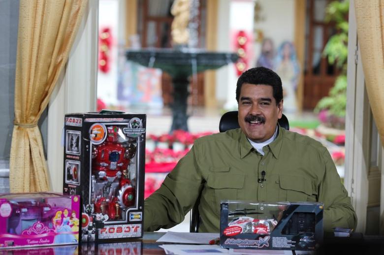Venezuela's President Nicolas Maduro speaks next to children toys during his weekly broadcast ''En contacto con Maduro'' (In contact with Maduro) at Miraflores Palace in Caracas, Venezuela December 18, 2016. Miraflores Palace/Handout via REUTERS