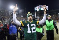 Jan 8, 2017; Green Bay, WI, USA;  Green Bay Packers quarterback Aaron Rodgers (12) celebrates as he leaves the field after defeating the New York Giants in the NFC Wild Card playoff football game at Lambeau Field. Mandatory Credit: Jerry Lai-USA TODAY Sports