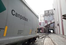 A Canpotex rail car waits to be loaded with potash at the Rocanville Potash Corp mine in Saskatchewan September 30, 2010. REUTERS/David Stobbe