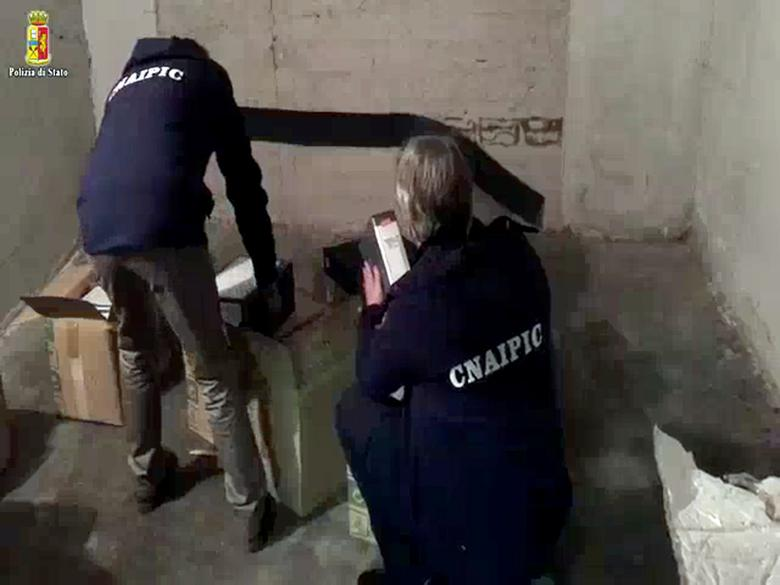 Police officers search documents in Rome in this handout video grab provided by the Italian Police on January 10, 2017. Polizia di Stato Press Office/Handout via REUTERS
