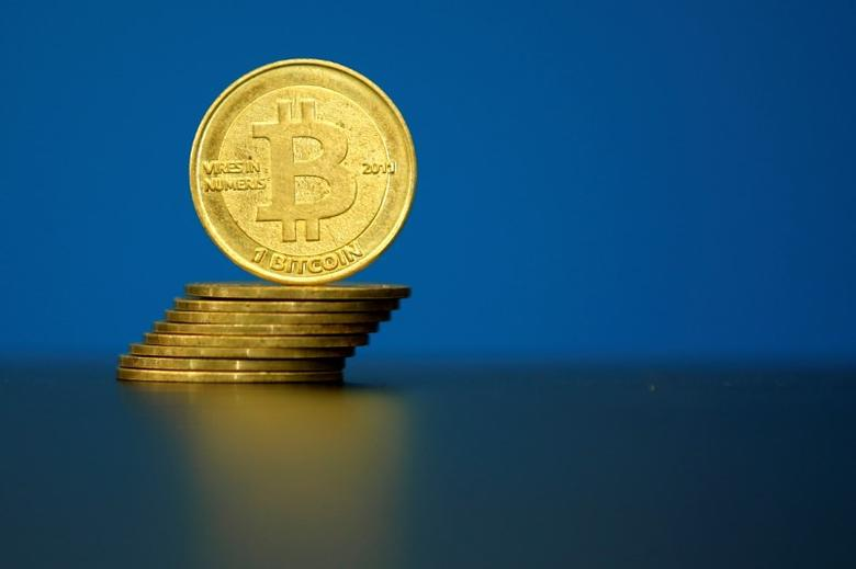 FILE PHOTO: Bitcoin (virtual currency) coins are seen in an illustration picture taken at La Maison du Bitcoin in Paris, France, May 27, 2015. REUTERS/Benoit Tessier/File Photo