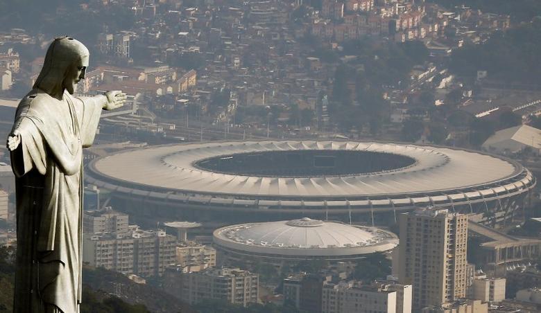 An aerial view shows the Christ the Redeemer statue with the Maracana stadium in Rio de Janeiro, Brazil, July 16, 2016. REUTERS/Ricardo Moraes