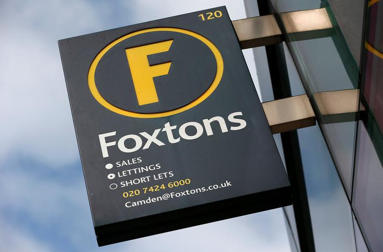 FILE PHOTO: A Foxtons estate agent sign is seen outside a branch in north London, Britain September 3, 2013. REUTERS/Suzanne Plunkett/File Photo