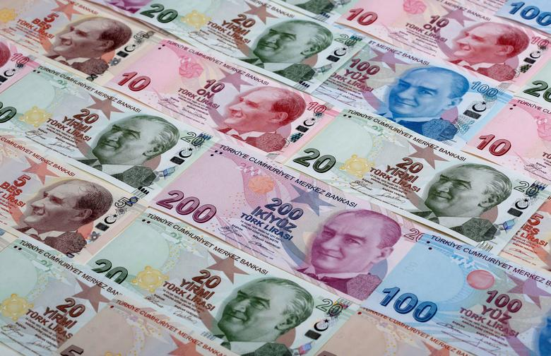 FILE PHOTO: Turkish lira banknotes are seen in this photo illustration shot January 7, 2014. REUTERS/Murad Sezer/Illustration/File Photo