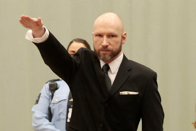 Anders Behring Breivik raises his right hand during the appeal case in Borgarting Court of Appeal at Telemark prison in Skien, Norway, 10 January 2017. NTB Scanpix/Lise Aaserud via REUTERS