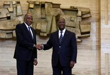 Ivory Coast President Alassane Ouattara (R) and new Prime Minister Amadou Gon Coulibaly pose for pictures in the Presidential Palace in Abidjan, Ivory Coast January 10, 2017. REUTERS/Thierry Gouegnon