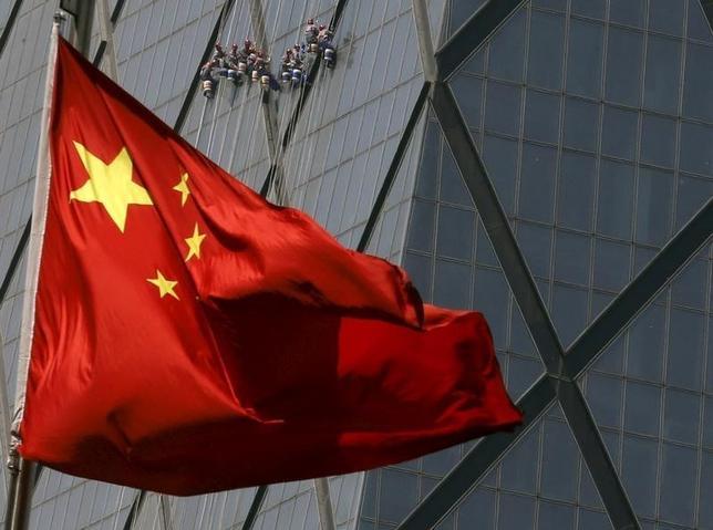 1月11日、中国の新華社通信は国営メディア5社を統合して「近代的な金融メディアグループ」を設立し、経済と金融関連のニュースの発信を強化すると発表した(2017年 ロイター/Kim Kyung-Hoon)