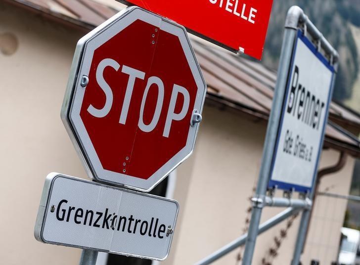 A street sign reading ''Stop - border control''  is pictured in the Italian village of Brenner on the Italian-Austrian border, Italy, May 3, 2016. REUTERS/ Dominic Ebenbichler  - RTX2CLPD