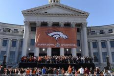 Feb 9, 2016; Denver, CO, USA; Denver Broncos players celebrate during the Super Bowl 50 championship parade at Civic Center Park. Mandatory Credit: Ron Chenoy-USA TODAY Sports