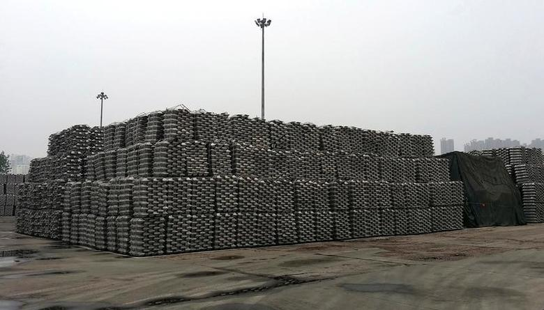 Aluminum ingots are piled up at a bonded storage area at the Dagang Terminal of Qingdao Port, in Qingdao, Shandong province June 7, 2014.    REUTERS/Fayen Wong/File Photo