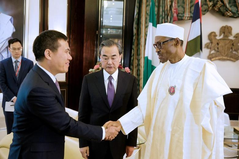 Nigeria's President Muhammadu Buhari greets China's Foreign Minister Wang Yi (C) and Chinese Ambassador to Nigeria Zhou Pingjian during their visit to the Presidential Villa in Abuja, Nigeria January 11, 2017. REUTERS/ Stringer