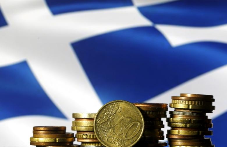 Euro coins are seen in front of a displayed Greece flag in this picture illustration, June 29, 2015. REUTERS/Dado Ruvic/File Photo