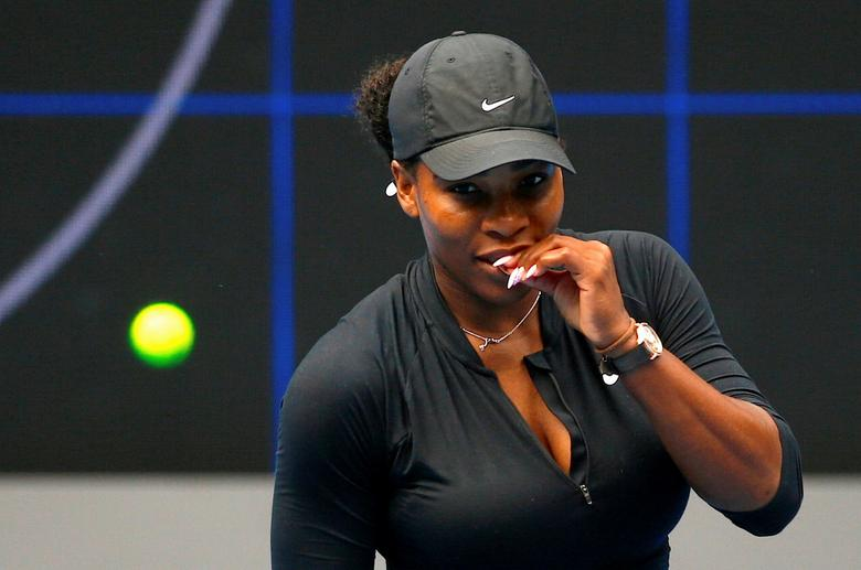 Serena Williams of the U.S. bites her finger during a training session ahead of the Australian Open tennis tournament in Melbourne, Australia, January 11, 2017.       REUTERS/David Gray
