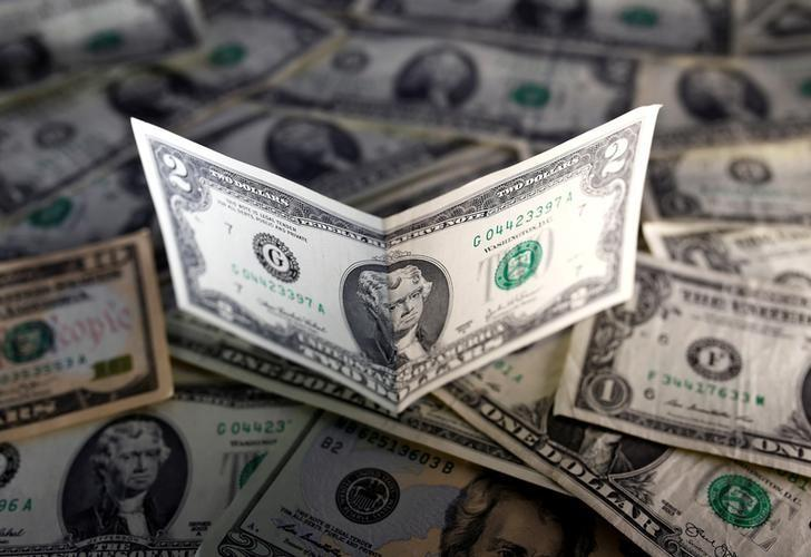 U.S. dollar notes are seen in this November 7, 2016 picture illustration. REUTERS/Dado Ruvic/Illustration