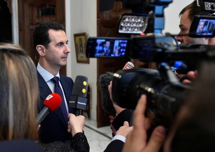 Syria's President Bashar al-Assad speaks to French journalists in Damascus, Syria, in this handout picture provided by SANA on January 9, 2017. SANA/Handout via REUTERS/Files
