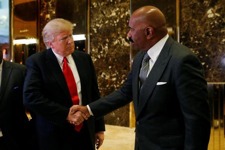 U.S.President-elect Donald Trump shakes hands with television personality Steve Harvey after their meeting at Trump Tower in New York, U.S., January 13, 2017. REUTERS/Shannon Stapleton