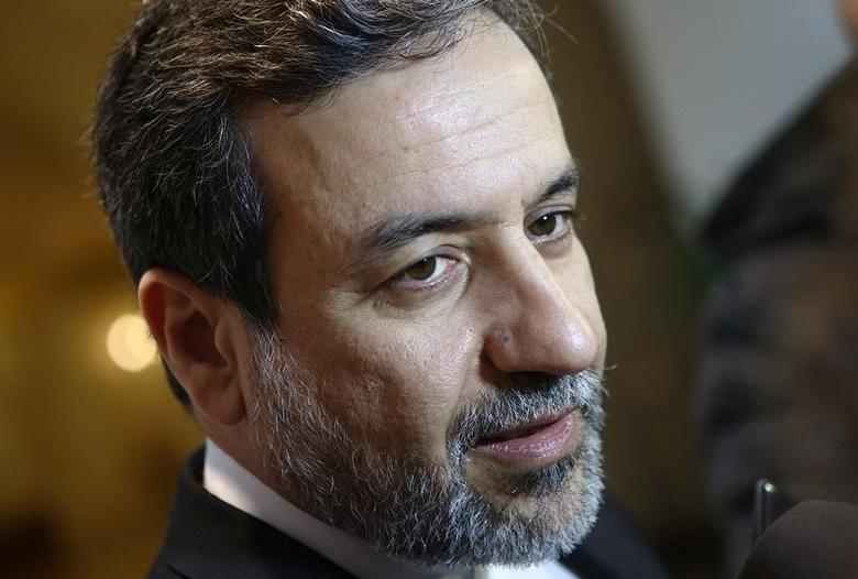 Iran's top nuclear negotiator Abbas Araqchi talks to journalists after meeting senior officials from the United States, Russia, China, Britain, Germany and France in a hotel in Vienna, Austria, October 19, 2015. REUTERS/Heinz-Peter Bader