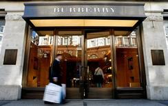 A customer walks in front of a Burberry store in central London July 15, 2008. REUTERS/Alessia Pierdomenico/File Photo
