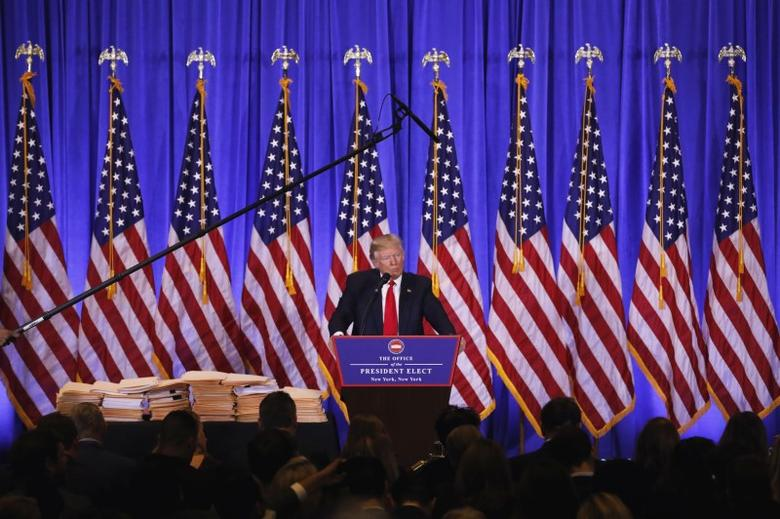 A microphone rises above U.S. President-elect Donald Trump during a news conference in the lobby of Trump Tower in Manhattan, New York City, U.S., January 11, 2017. REUTERS/Lucas Jackson