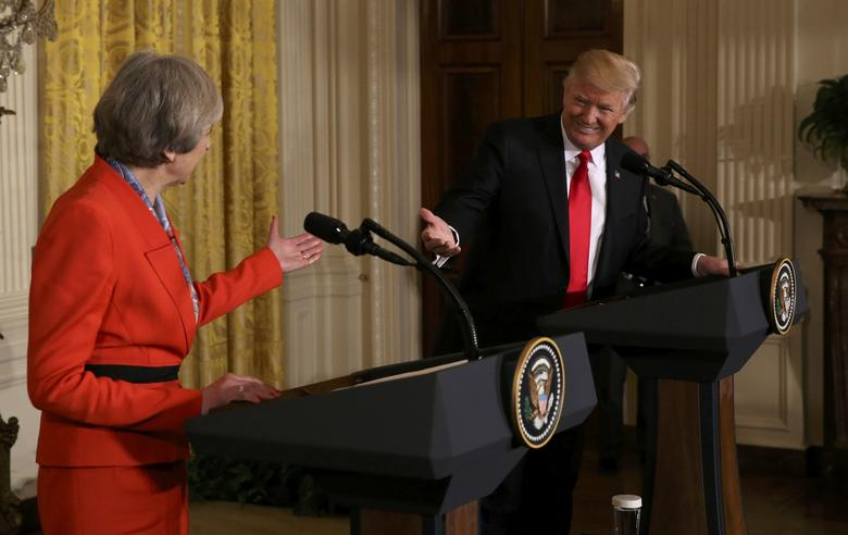 U.S. President Donald Trump and British Prime Minister Theresa May gesture at one another as they hold a joint news conference at the White House in Washington, U.S., January 27, 2017.    REUTERS/Carlos Barria