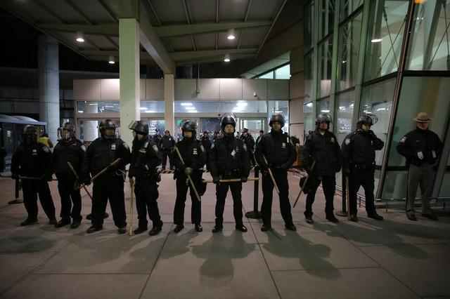 Port Authority Police Department block an entrance as protesters gather outside Terminal 4 at JFK airport in opposition to U.S. president Donald Trump's proposed ban on immigration in Queens, New York City, U.S., January 28, 2017. REUTERS/Stephen Yang