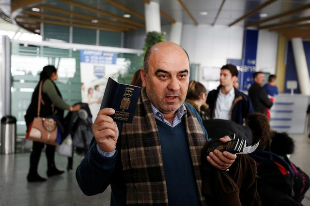 Fuad Sharef Suleman shows his passport to the media after U.S. President Donald Trump's decision to temporarily bar travellers from seven countries, including Iraq, at Erbil International Airport, Iraq, January 29, 2017. REUTERS/Ahmed Saad