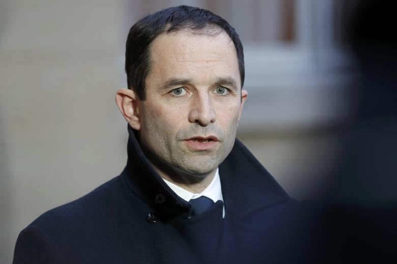 Benoit Hamon, French Socialist party's 2017 presidential candidate, talks to journalists as he leaves after a meeting with the French Prime Minister at the Hotel Matignon in Paris, France, January 30, 2017.  REUTERS/Philippe Wojazer