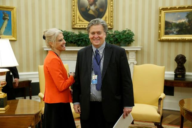 White House Senior Advisor Kellyanne Conway smiles with chief strategist Steve Bannon in the Oval Office.  REUTERS/Jonathan Ernst