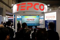 Visitors gather in front of Tokyo Electric Power Co's (TEPCO) booth at the Energy Market Liberalisation Expo in Tokyo, Japan March 2, 2016. REUTERS/Toru Hanai