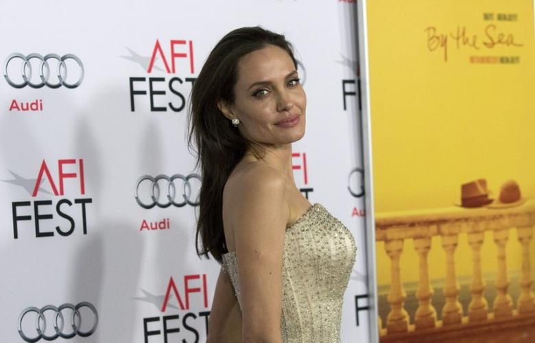 Director and cast member Angelina Jolie poses at the premiere of ''By the Sea'' during the opening night of AFI FEST 2015 in Hollywood, California November 5, 2015. REUTERS/Mario Anzuoni