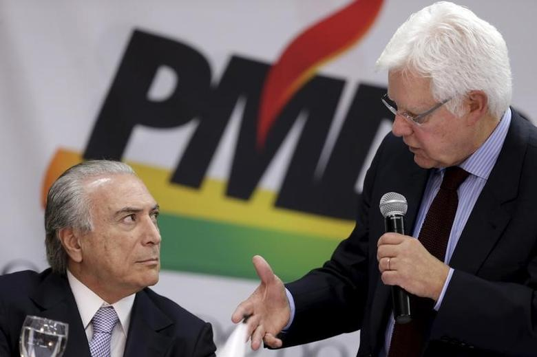 Brazil's Vice President Michel Temer (L) listens to Moreira Franco during a meeting with members of the Party of the Brazilian Democratic Movement (PMDB) in Brasilia May 7, 2015. REUTERS/Ueslei Marcelino