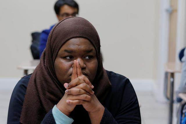 Tenth grade student Ayia Elsadig listens as Nadeem Mazen, Cambridge city councillor, Muslim and founder of JetPAC, speaks to her AP Government class at Al-Noor Islamic high school in Mansfield, Massachusetts, U.S. February 2, 2017. REUTERS/Brian Snyder