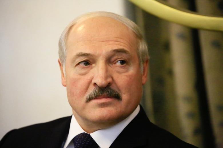 Belarus President Alexander Lukashenko looks on as he is welcomed by SudanÕs President Omar Hassan al-Bashir at Khartoum Airport, Sudan January 16, 2017. REUTERS/Mohamed Nureldin Abdallah.