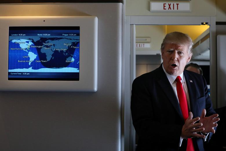 U.S. President Donald Trump talks to journalists members of the travel pool on board the Air Force One during his trip to Palm Beach, Florida while flying over South Carolina, U.S., February 3, 2017. REUTERS/Carlos Barria