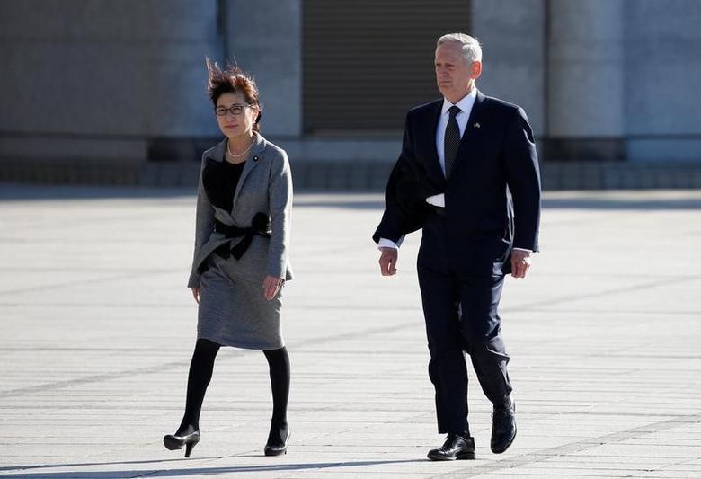 U.S. Defense Secretary Jim Mattis and Japan's Defense Minister Tomomi Inada (L) walk as they review the honour guard at the Defense Ministry in Tokyo, Japan, February 4, 2017. REUTERS/Toru Hanai