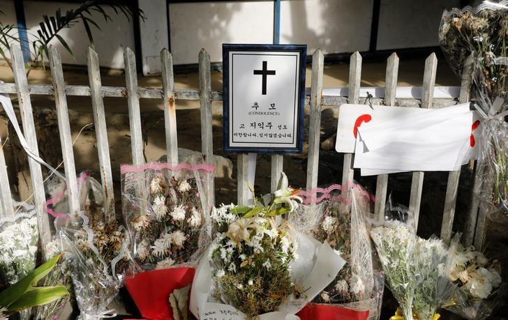 Flowers are seen placed at the site where South Korean businessman Jee Ick-Joo was allegedly killed by policemen inside Camp Crame police camp, in Quezon city Metro Manila, Philippines February 6, 2017. REUTERS/Erik De Castro